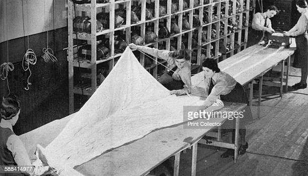 Members of the WAAF serving in Coastal Command circa 1940 Members of the Women's Auxiliary Air Force packing parachutes during World War IIFrom...