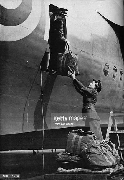 Members of the WAAF serving in Coastal Command circa 1940 Two members of the Women's Auxiliary Air Force putting their air crew's equipment aboard a...