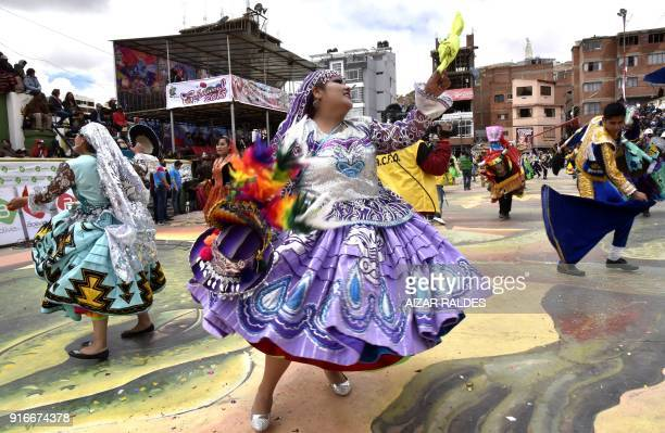 Members of the Waca Wacas traditional folk dance group participate in the traditional inaugural parade of Oruro's Carnival declared Unesco World...