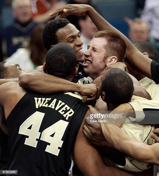 Members of the Wake Forest Demon Deacons lift Ishmael Smith top left into the air after he hit a last second shot in overtime to beat the Texas...