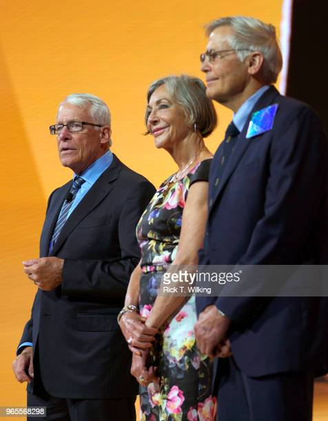 Members of the Walton family Rob Alice and Jim speak during the annual Walmart shareholders meeting event on June 1 2018 in Fayetteville Arkansas The...