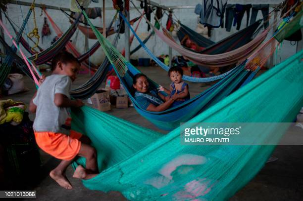TOPSHOT Members of the Warao tribe Venezuela's secondlargest indigenous group rest in hammocks at the Janokoida shelter where they have been taking...