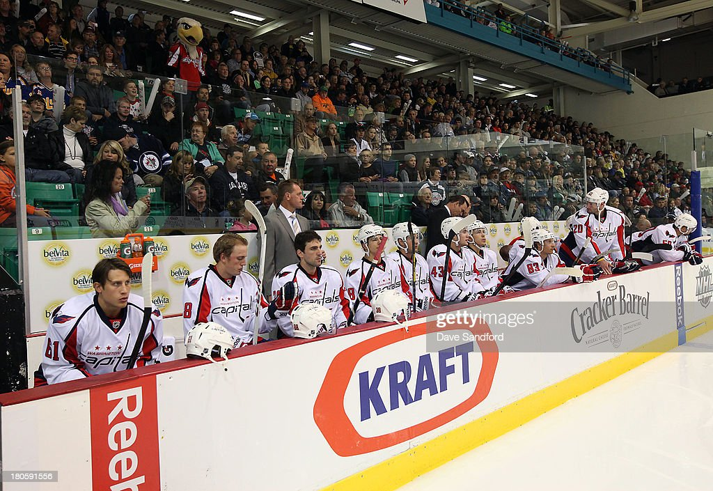 Members of the Washington Capitals sit on the bench prior to facing the Winnipeg Jets during Kraft Hockeyville Day 2 at Yardmen Arena on September 14, 2013 in Belleville, Ontario, Canada.