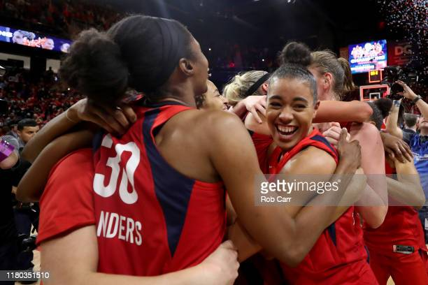 Members of the Washington Mystics celebrate after defeating the Connecticut Sun to win the 2019 WNBA Finals at St Elizabeths East Entertainment...