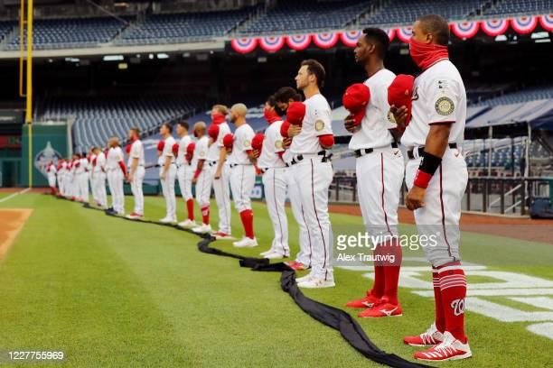 Members of the Washington Nationals are seen on the field during the national anthem prior to the game between the New York Yankees and the...