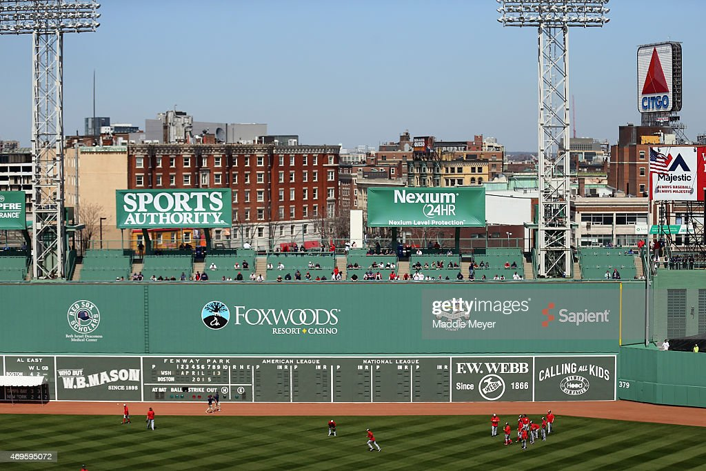 Members of the Washington Nationals warm up before their game against the Boston Red Sox at Fenway Park on April 13, 2015 in Boston, Massachusetts.