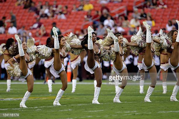 Members of the Washington Redskins cheerleaders preform during the Redskins preseason game against the Tampa Bay Buccaneers at FedExField on...