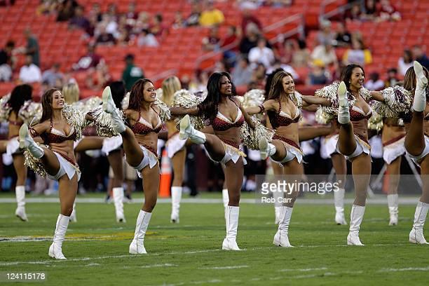 Members of the Washington Redskins cheerleaders preform during the Redskins preseason game against the Tampa Bay Buccaneers at FedExField on...