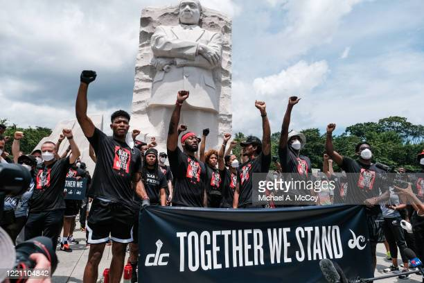 Members of the Washington Wizards and Washington Mystics basketball teams rally at the MLK Memorial to support Black Lives Matter and to mark the...