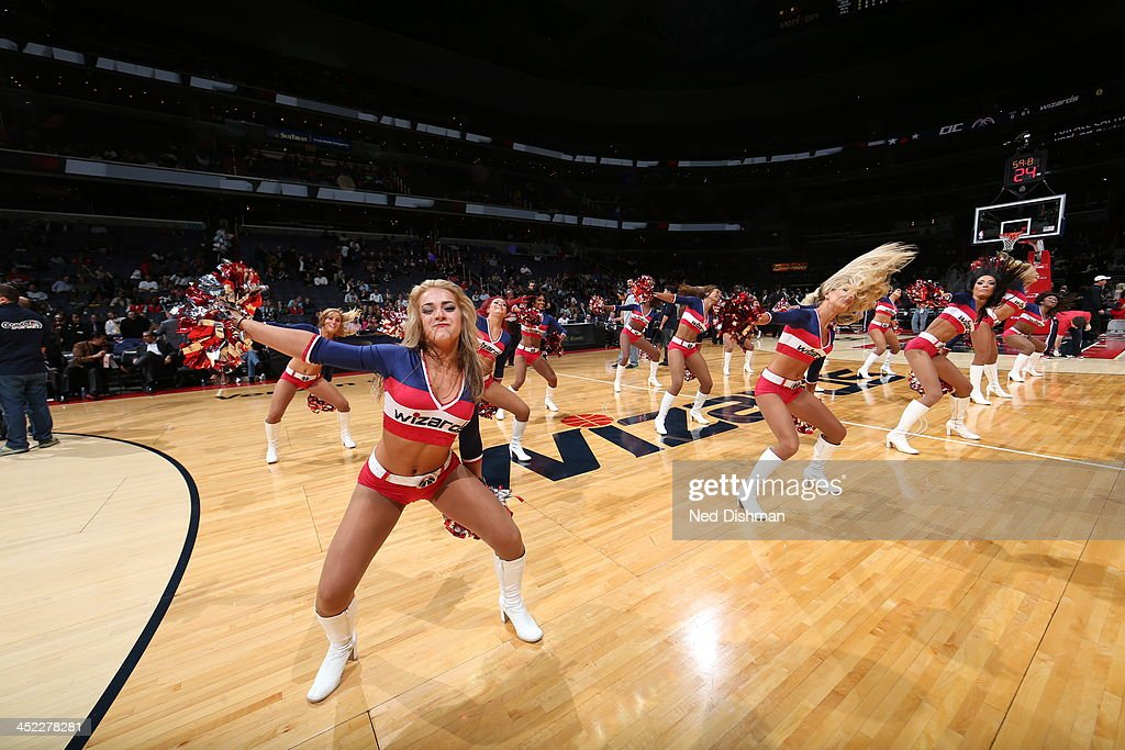 Members of the Washington Wizards dance team performs for the crowd against the Minnesota Timberwolves during the game at the Verizon Center on November 19, 2013 in Washington, DC.