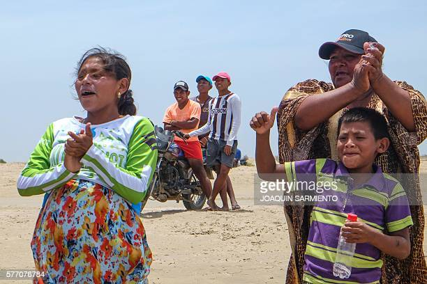 Members of the Wayuu indigenous ethnia cheer during the Third Kite Addict Colombia tournament in Cabo de la Vela Guajira Department Colombia on July...
