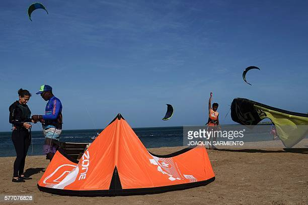 Members of the Wayuu indigenous ethnia give kitesurfing lessons in Cabo de la Vela Guajira Department Colombia on July 4 2016 In Cabo de la Vela a...