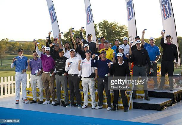 Members of the Webcom Tour top25 pose with their PGA TOUR cards during a ceremony after the final round of the Webcom Tour Championship at TPC Craig...