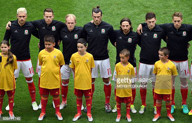 members of the Welsh football team from left Wales' midfielder Aaron Ramsey defender Chris Gunter midfielder Jonathan Williamsforward Gareth Bale...