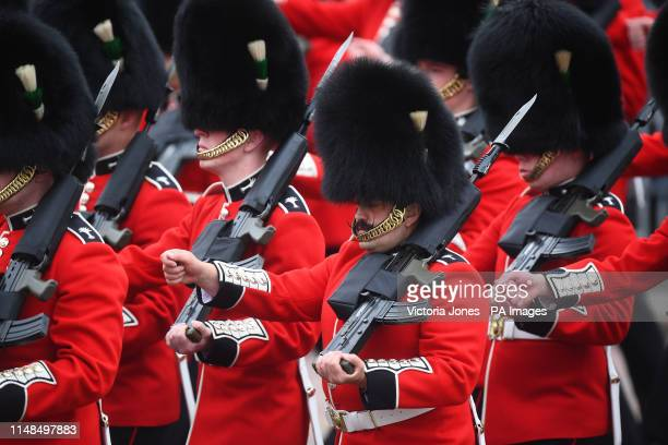 Members of the Welsh Guards, a regiment of Household Division, march to Horse Guards Parade, London with their rifles in hand, ahead of the Trooping...
