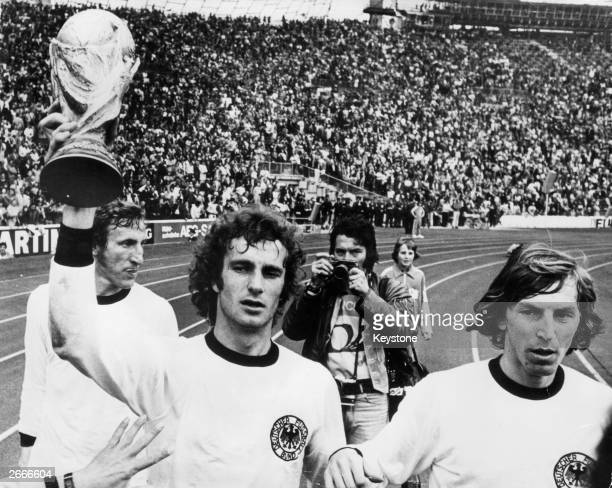 Members of the West Germany football team celebrate their 21 win over Holland in the World Cup Final in Munich