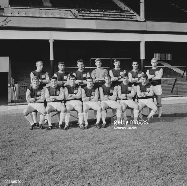 Members of the West Ham United FC team squad pose for a group photo together on the pitch at West Ham's Boleyn Ground stadium in London on 24th...