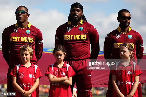 Members of the West Indian cricket team line up for the national anthem during the 2015 ICC Cricket World Cup match between the West Indies and...