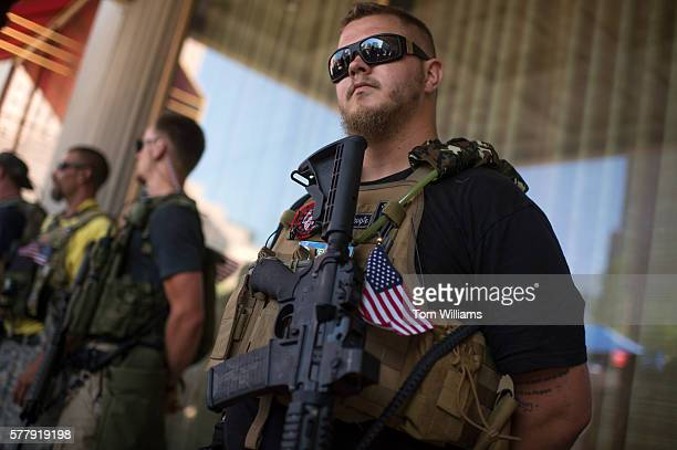 Members of the West Ohio Minutemen practice their right to carry firearms near the Republican National Convention at the Quicken Loans Arena in...