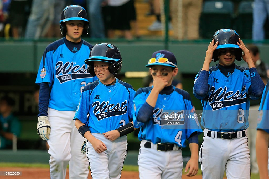 Members of the West Team from Las Vegas, Nevada walk off the field following their 7-5 loss to the Great Lakes Team from Chicago, Illinois during the United States Championship game of the Little League World Series at Lamade Stadium on August 23, 2014 in South Williamsport, Pennsylvania.