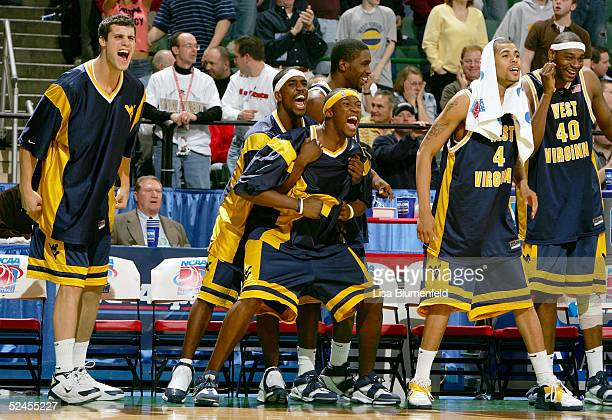 Members of the West Virginia Mountaineers celebrate as they defeated the Wake Forest Demon Deacons 111105 in the double overtime during the second...