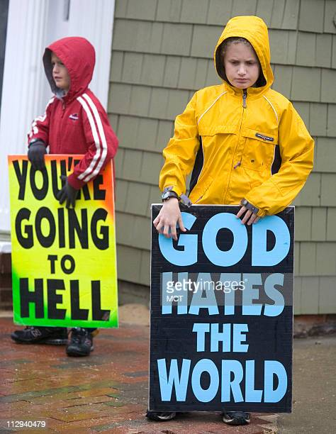 Members of the Westboro Baptist Church an antigay group protest the 'fag infested US Navy' outside of the US Naval Academy October 25 2007 The group...