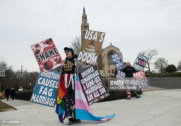 Members of the Westboro Baptist Church demonstrate outside the Basilica of the National Shrine of the Immaculate Conception before the funeral...