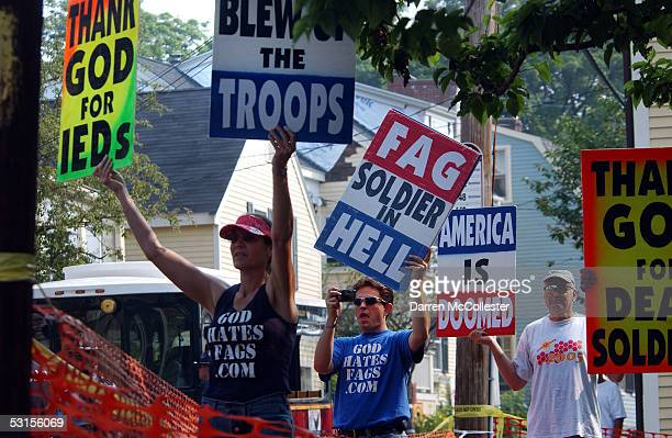Members of the Westboro Baptist Church in Kansas hold signs June 27, 2005 while protesting during a funeral for Staff Sgt. Christopher Piper in...