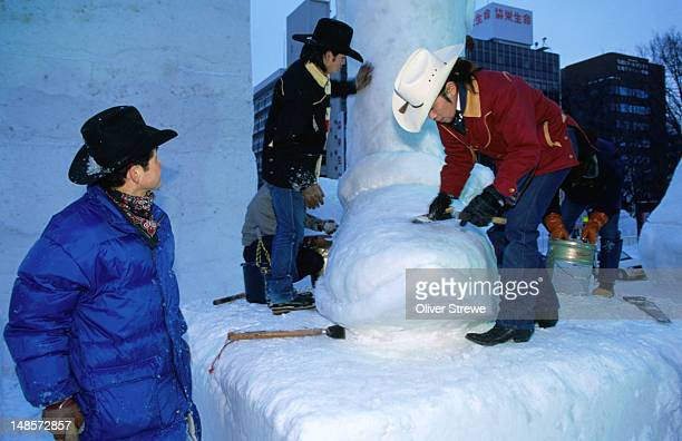 Members of the Western club carving a cowboy book at Sapporo Yuki Matsuri (snow festival) where hundreds of visitors come to admire the amazing ice sculptures and carvings