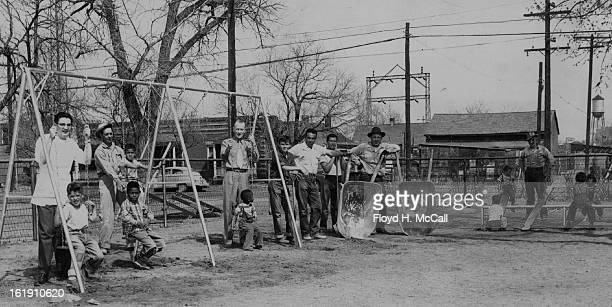 Members of the Westwood Lions club take a breather after installing four new swings and four new teeters at Rude Park nursery, 1307 Decatur street....