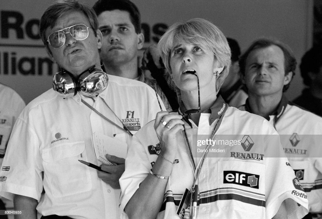 Members of the Williams team watch a replay of race car driver Ayrton Senna's accident during the San Marino Grand Prix on the Imola Circuit, Imola, Italy, May 1, 1994. Senna died a few hours later in a hospital in Bologna.