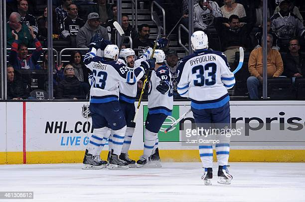 Members of the Winnipeg Jets celebrate a goal during a game against the Los Angeles Kings at STAPLES Center on January 10 2015 in Los Angeles...