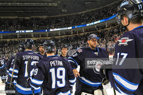 Members of the Winnipeg Jets celebrate following a 54 victory over the Minnesota Wild at the MTS Centre on October 25 2015 in Winnipeg Manitoba Canada
