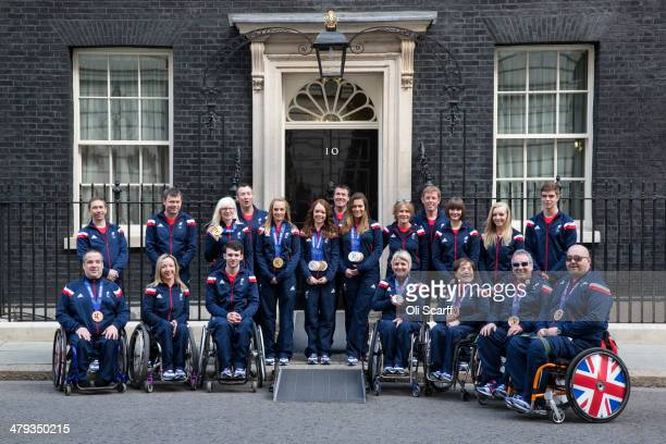 Members of the Winter Paralympic Team GB pose for a photograph in front of Number 10 Downing Street upon their return from the Sochi Paralympic...
