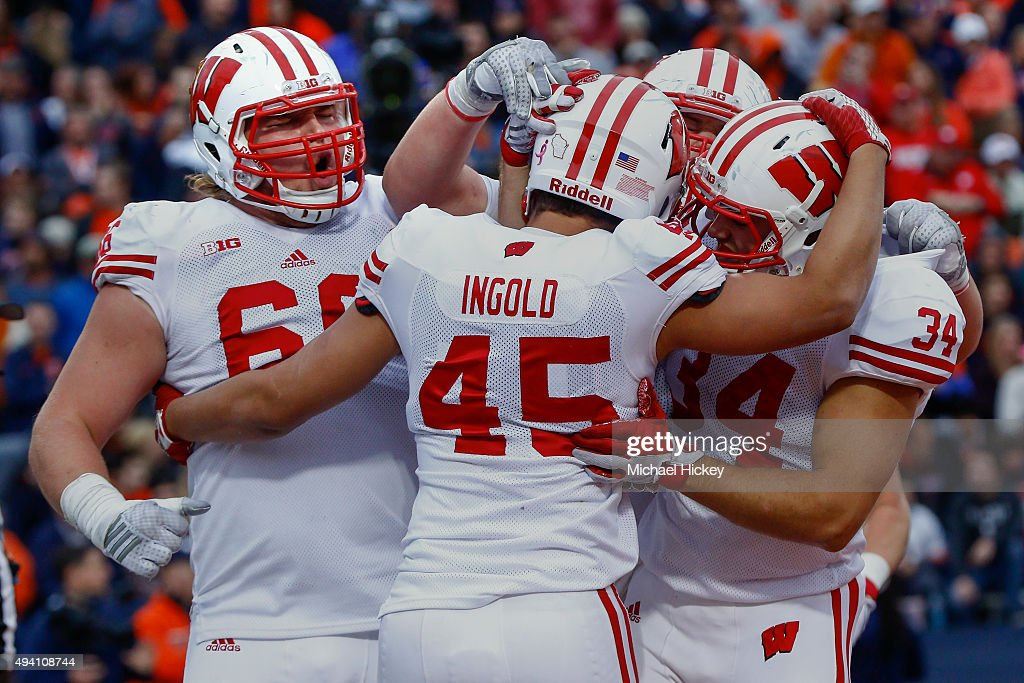 Members of the Wisconsin Badgers celebrate during the game against the Illinois Fighting Illini at Memorial Stadium on October 24, 2015 in Champaign, Illinois. Wisconsin defeated Illinois 24-13.
