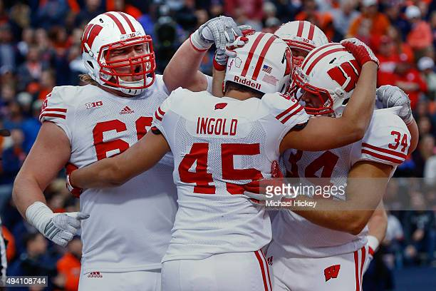 Members of the Wisconsin Badgers celebrate during the game against the Illinois Fighting Illini at Memorial Stadium on October 24 2015 in Champaign...