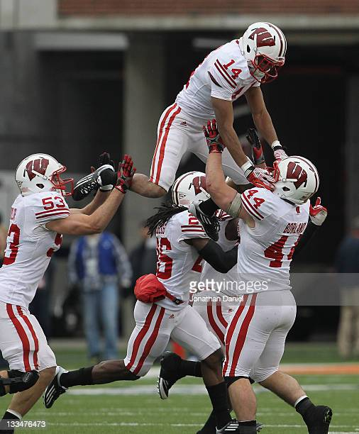Members of the Wisconsin Badgers including Mike Taylor Antonio Fenelus Marcus Cromartie and Chris Borland celebrate a turnover against the Illinois...