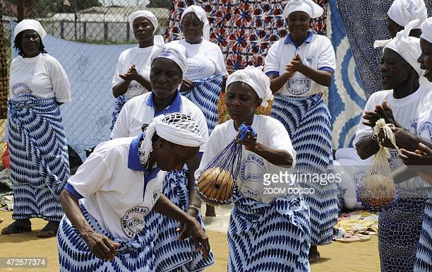 Members of the Women In Peacebuilding Network dance, sing and pray on May 8, 2015 in Monrovia. If there are no new infections in the next 48 hours,...