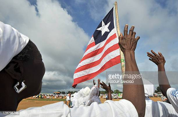Members of the Women in Peacebuilding Program Network perform a collective prayer on Ocotober 6 2011 in Moronvia five days ahead of Liberia's general...