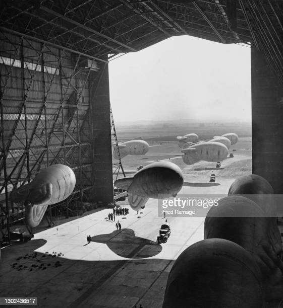 Members of the Women's Auxiliary Air Force of No 1 RAF Balloon Training Unit, RAF Balloon Command manoeuvre anti aircraft defence barrage balloons...
