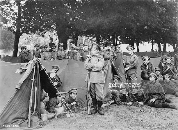 Members of the Women's Battalion of Death an antiBolshevik infantry group stand around tents at camp