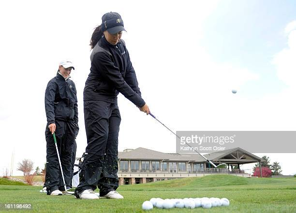 Members of the CU women's golf team practice at the Fox Hill Country Club in Longmont as they prepare for the NCAA regional tournament One of CU's...