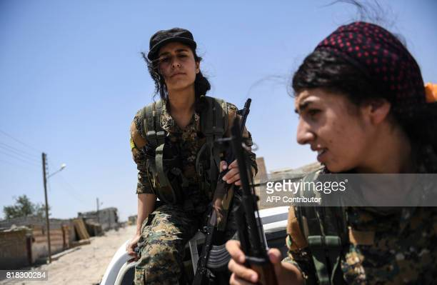 Members of the Women's Protection Units arrive on the frontline on the eastern outskirts of Raqa on July 18 during the ongoing offensive by the...