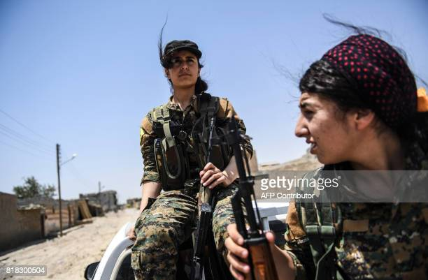 TOPSHOT Members of the Women's Protection Units arrive on the frontline on the eastern outskirts of Raqa on July 18 during the ongoing offensive by...