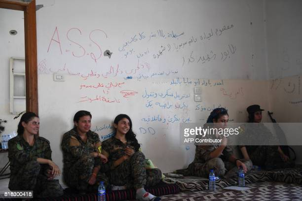 Members of the Women's Protection Units rest in abandoned home used as their base in AlMeshleb on the eastern outskirts of Raqa on July 18 during the...