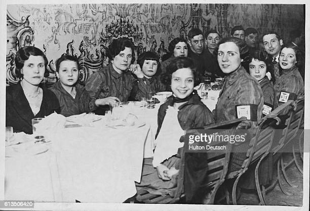 Members of the women's section of the Portugese fascist party known as the Blue Shirts or National Syndicalists holding a luncheon in honour of their...