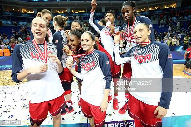 Members of the Women's Senior US National Team celebrate their medal after defeating Spain during the finals of the 2014 FIBA World Championships on...