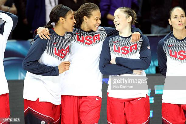 Members of the Women's Senior US National Team share a laugh before receiving their medal after defeating Spain during the finals of the 2014 FIBA...