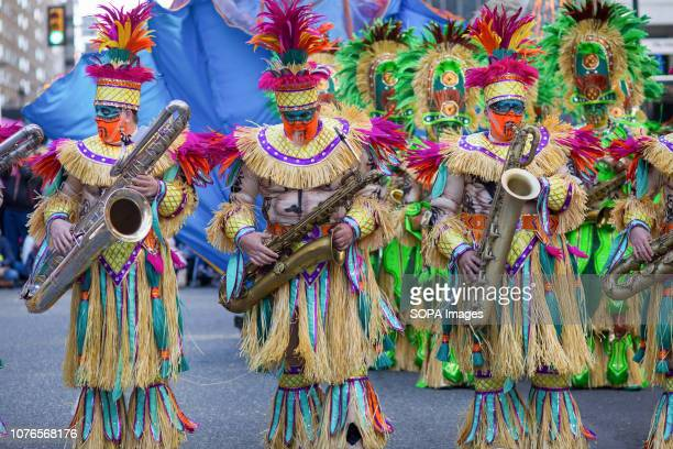 Members of the Woodland string band participate in the Philadelphia Mummers Parade a New Years Day tradition Hundreds of performers comics and...