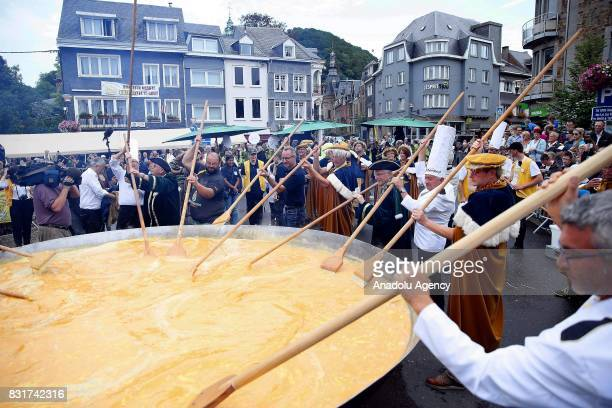 Members of the World Brotherhood of the Huge Omelet cook giant omlette within a 4 metre diameter frying pan in Malmedy Belgium on August 15 2017...